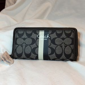 Black leather Coach wallet with wrist strap NWT.